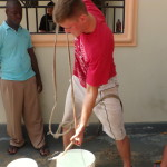 Micah, drawing water from a neighbors cistern.